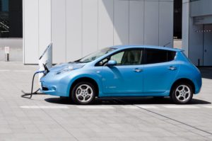 """Yokohama, Japan - August 30, 2011: A Nissan's electric car """"Nissan Leaf"""" is being charged at the charging station on Nissan's global headquarters located in Yokohama, Japan."""